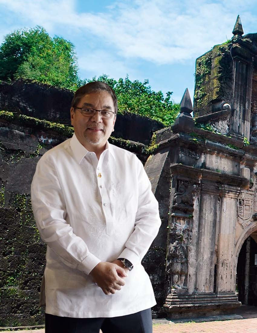 Photo of DoT Sec Ramon Jimenez in front of Intramuros