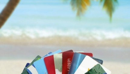 Photo of credit cards with beach scene as background