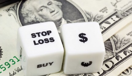 Photo of dice with the word stop and currency symbols