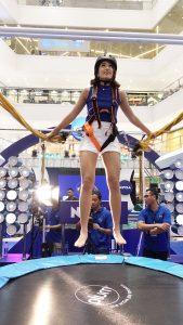 NIVEA Brand Ambassador Gretchen Ho jumping at the NIVEA Skin Firmness Check.